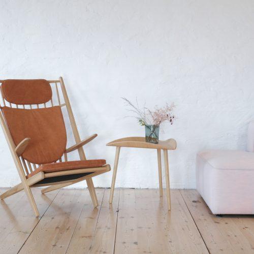 cognac leather goliat armchair next to trias table