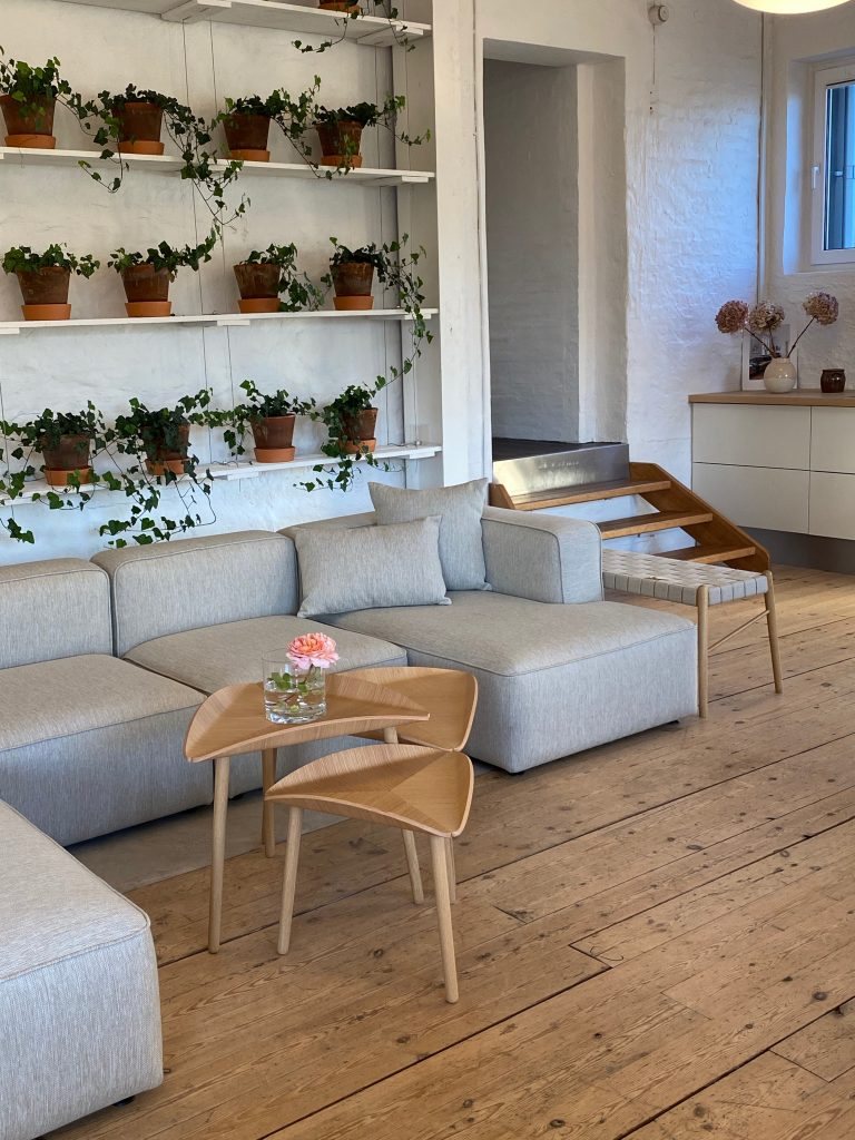two trias tables with basecamp sofa